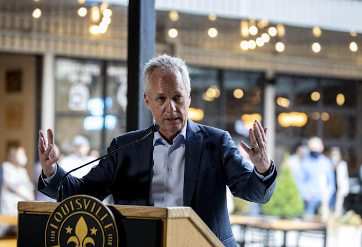 Louisville Mayor Greg Fischer speaks during the grand opening of the Nulu Marketplace at the 800 block of E. Market and E. Main streets. April 8, 2021