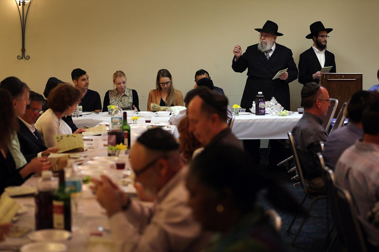 MIAMI BEACH, FL - MARCH 25:  Rabbi Efraim Katz (2nd R) leads a community Passover Seder at Beth Israel synagogue  on March 25, 2013 in Miami Beach, Florida. The community Passover Seder that served around 150 people has been held for the past 30 years and is welcome to anyone in the community that wants to commemorate the emancipation of the Israelites from slavery in ancient Egypt.  (Photo by Joe Raedle/Getty Images)