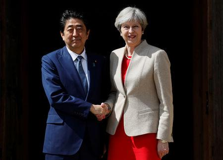 Britain's Prime Minister Theresa May greets Prime Minister Shinzo Abe of Japan during a visit to Chequers, near Wendover, Britain April 28, 2017.  REUTERS/Kirsty Wigglesworth/Pool