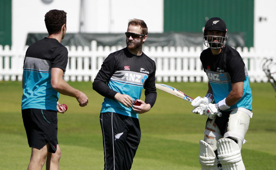 New Zealand captain Kane Williamson, centre, talks with teammate's Mitchell Santner, left, and Daryl Mitchell during a practice session at Lord's Cricket Ground in London, Monday, May 31, 2021.New Zealand will play England in the first of two tests here starting June 2. (AP Photo/Ian Walton/Pool)