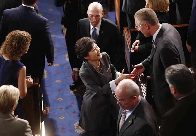 South Korea's President Park Geun-hye greets lawmakers as she leaves the chamber after she addressed a joint session of Congress on Capitol Hill in Washington, Wednesday, May 8, 2013. (AP Photo/Charles Dharapak)