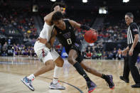 Washington's Jaden McDaniels, right, drives into Arizona's Josh Green during the first half of an NCAA college basketball game in the first round of the Pac-12 men's tournament Wednesday, March 11, 2020, in Las Vegas. (AP Photo/John Locher)