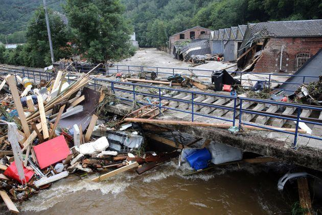 This picture taken in Pepinster on July 16, 2021 shows debris piled up next to a bridge after the flood. The situation remains critical as the water keep rising after the heavy rainfall of the previous days. - The death toll from devastating floods in Europe soared to at least 126 on July 16, 2021, most in western Germany where emergency responders were frantically searching for missing people. In Belgium, the government confirmed the death toll had jumped to 20 -- earlier reports had said 23 dead -- with more than 21,000 people left without electricity in one region. (Photo by François WALSCHAERTS / AFP) (Photo by FRANCOIS WALSCHAERTS/AFP via Getty Images) (Photo: FRANCOIS WALSCHAERTS via Getty Images)