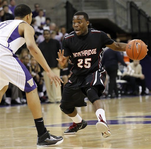 Cal State Northridge's Allan Guei (25) tries to get around Washington's Abdul Gaddy in the first half of an NCAA college basketball game on Thursday, Dec. 22, 2011, in Seattle. (AP Photo/Elaine Thompson)