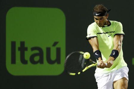 Mar 29, 2017; Miami, FL, USA; Rafael Nadal of Spain hits a backhand against Jack Sock of the United States (not pictured) on day nine of the 2017 Miami Open at Crandon Park Tennis Center. Nadal won 6-2, 6-3. Mandatory Credit: Geoff Burke-USA TODAY Sports