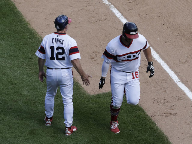 Chicago White Sox's Daniel Palka, right, celebrates with third base coach Nick Capra after hitting a solo home run during the fourth inning of a baseball game against the Boston Red Sox, Sunday, Sept. 2, 2018, in Chicago. (AP Photo/Nam Y. Huh)