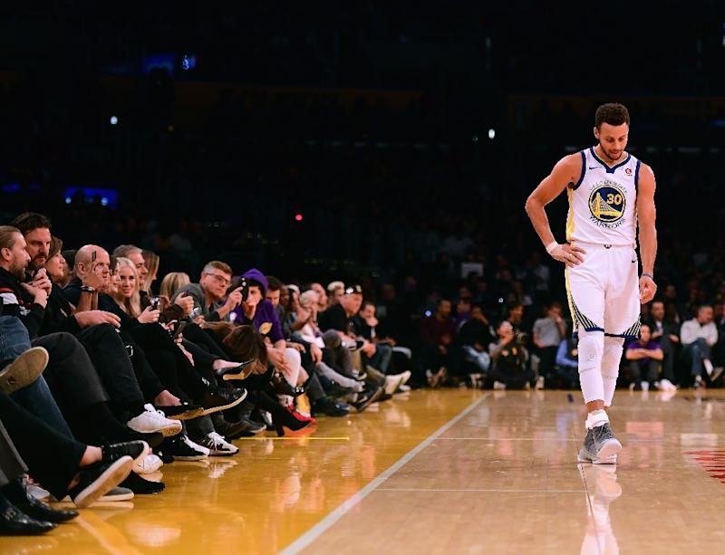 Golden State Warriors star Stephen Curry injures right ankle against New Orleans