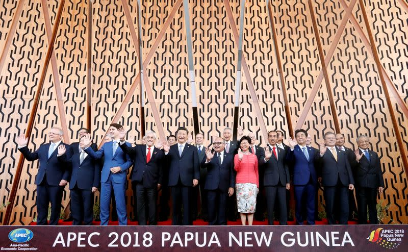 FILE PHOTO: Leaders pose for a family picture at the APEC Summit in Port Moresby