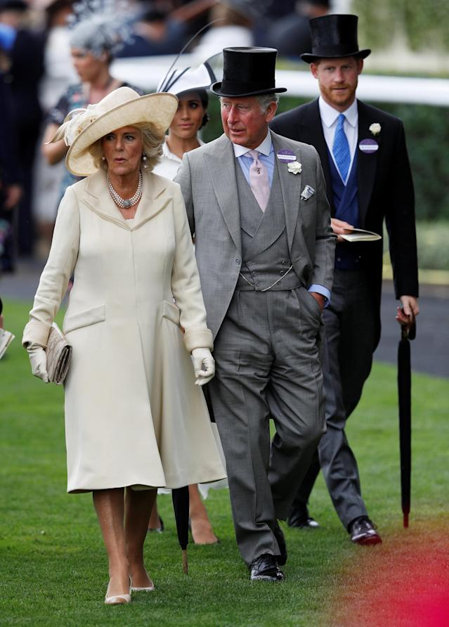 Horse Racing - Royal Ascot - Ascot Racecourse, Ascot, Britain - June 19, 2018 Charles, Prince of Wales, Camilla, Duchess of Cornwall, Britain's Prince Harry and Meghan, the Duchess of Sussex arrive at Ascot racecourse REUTERS/Peter Nicholls