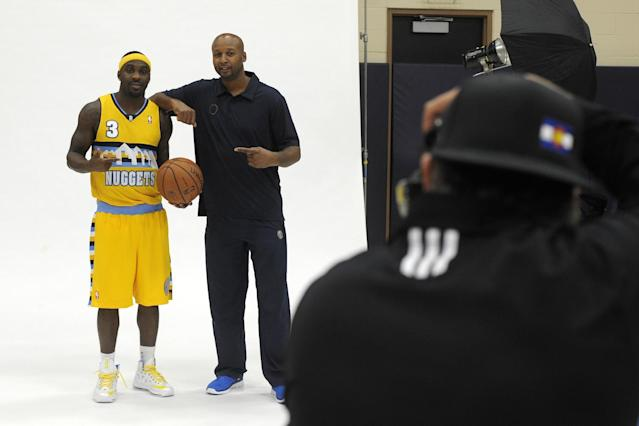 New head coach of the Denver Nuggets, Brian Shaw, and Ty Lawson pose for a photo during the Nuggets NBA basketball media day on Monday, Sept. 30, 2013, in Denver. (AP Photo/Jack Dempsey
