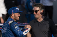 Kyle Larson, left, and Jeff Gordon shake hands in Victory Lane after a NASCAR Cup Series auto racing race at Charlotte Motor Speedway, Sunday, Oct. 10, 2021, in Concord, N.C. (AP Photo/Matt Kelley)