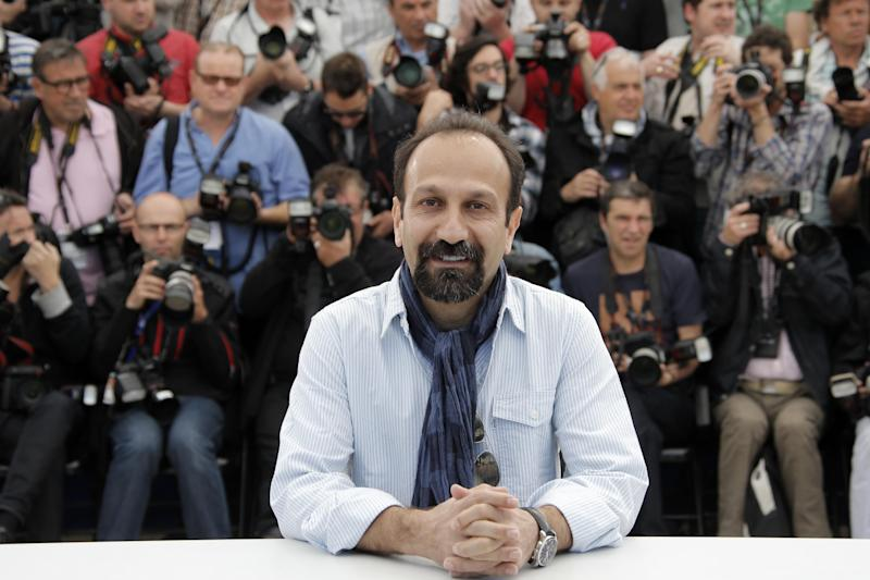 Director Asghar Farhadi poses for photographers during a photo call for the film The Past at the 66th international film festival, in Cannes, southern France, Friday, May 17, 2013. (AP Photo/Francois Mori)