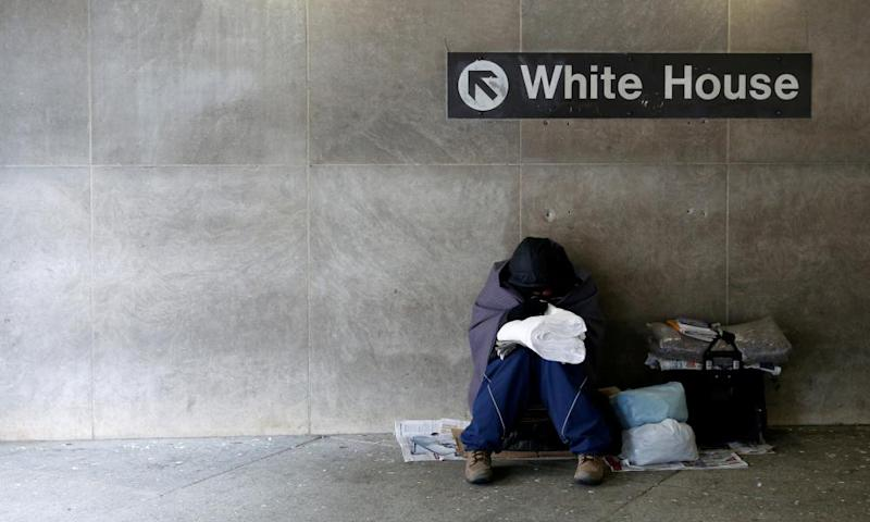 A homeless person sits near the White House in Washington.