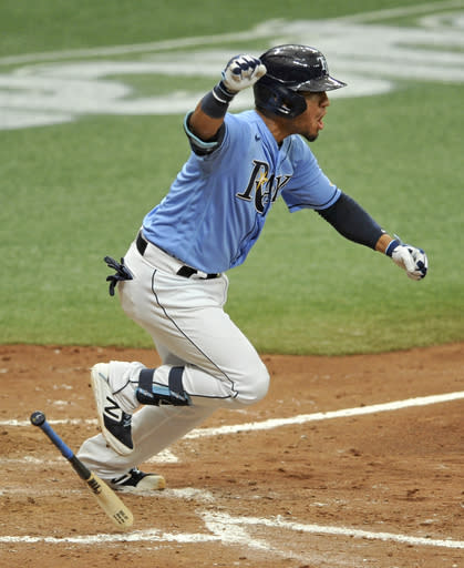 Tampa Bay Rays pinch hitter Michael Perez celebrates his winning RBI off New York Yankees closer Zack Britton during the ninth inning of a baseball game Sunday, Aug. 9, 2020, in St. Petersburg, Fla. (AP Photo/Steve Nesius)