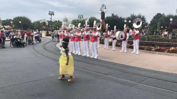 PHOTO: Sydney Elise Russell dances in the street at Walt Disney World as the Walt Disney World marching band joins in. (Tiffany McKinnon Russell)