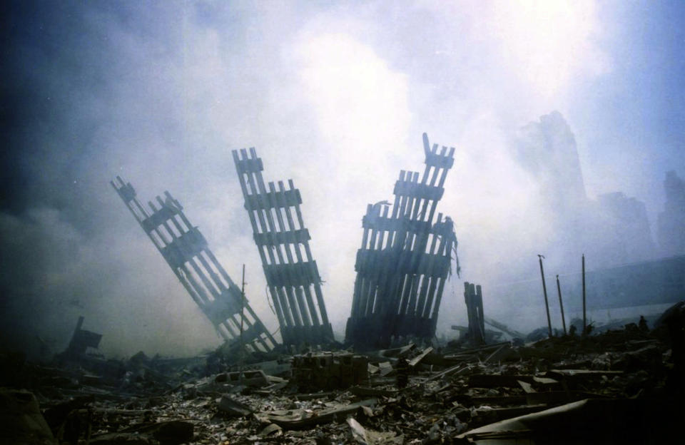 <p>The remains of the World Trade Center stands amid the debris in New York, Tuesday, Sept. 11, 2001. (AP Photo/Alexandre Fuchs)</p>