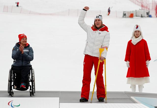 Alpine Skiing - Pyeongchang 2018 Winter Paralympics - Women's Slalom - Sitting - Jeongseon Alpine Centre - Jeongseon, South Korea - March 18, 2018 - Bronze medallist Heike Eder of Austria celebrates winning the bronze as gold medallist Anna-Lena Forster (L)of Germany claps. REUTERS/Paul Hanna