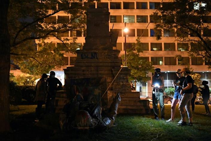 A statue of Confederate general Albert Pike was torn down by demonstrators in the capital and set on fire, in an act condemned by President Trump (AFP Photo/Eric BARADAT)