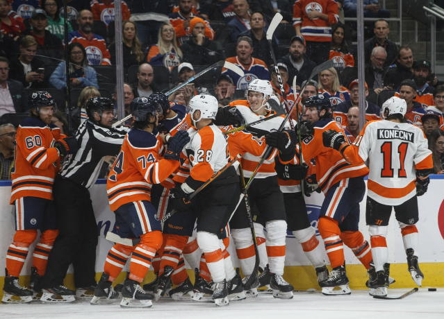 Philadelphia Flyers and Edmonton Oilers rough it up during the third period of an NHL hockey game Wednesday, Oct. 16, 2019, in Edmonton, Alberta. (Jason Franson/The Canadian Press via AP)