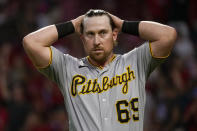Pittsburgh Pirates' John Nogowski (69) reacts after striking out in the fourth inning of a baseball game against the Cincinnati Reds in Cincinnati on Thursday, Aug. 5, 2021. (AP Photo/Jeff Dean)