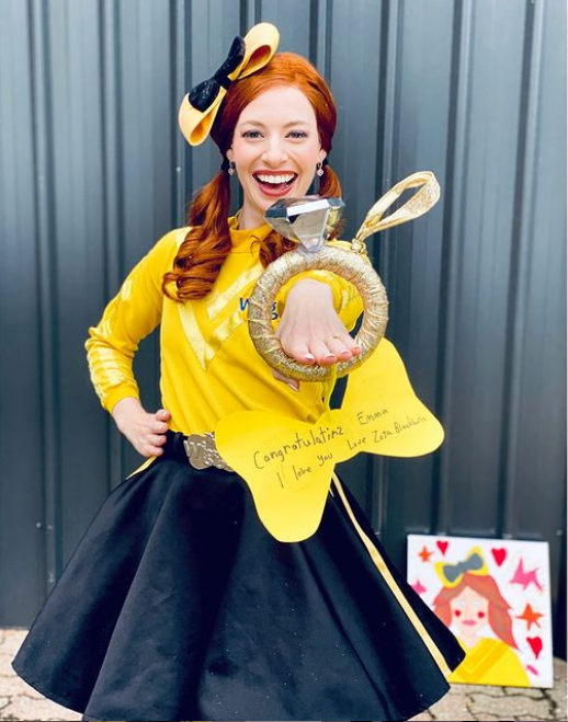 Emma Watkins holding out a giant ring