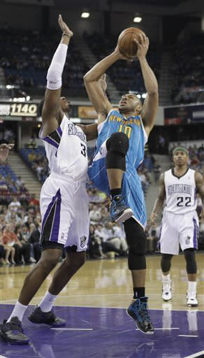 New Orleans Hornets guard Eric Gordon, front right, shoots against Sacramento Kings forward Jason Thompson during the first quarter of an NBA basketball game in Sacramento, Calif., Wednesday, April 10, 2013. (AP Photo/Rich Pedroncelli)