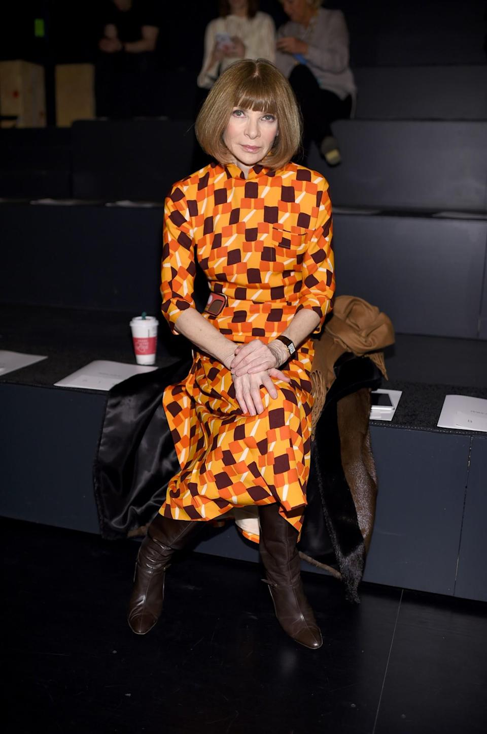<p>Anna Wintour turned up in a rather bright printed dress. <i>[Photo: Getty]</i> </p>