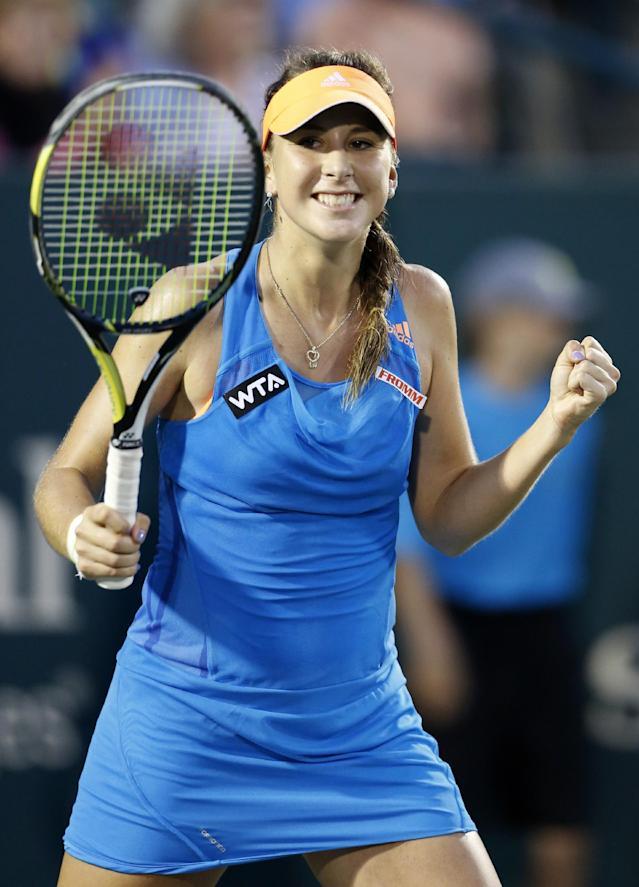 Belinda Bencic, of Switzerland, reacts to defeating Sara Errani, of Italy, in three sets during the Family Circle Cup tennis tournament in Charleston, S.C., Friday, April 4, 2014. (AP Photo/Mic Smith)