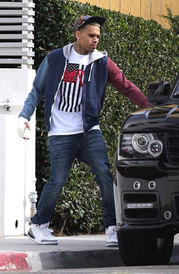 EXCLUSIVE: Chris Brown leaves his Hollywood home with his right hand in a cast following his bust-up with singer Frank Ocean at an LA recording studio.