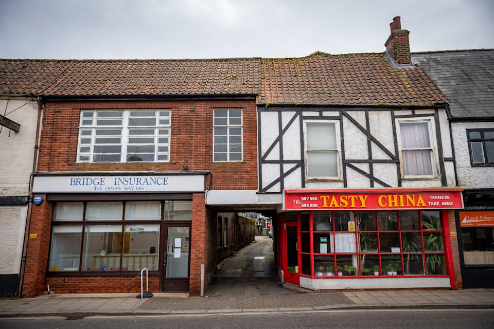 TThe property (in between Bridge Ins and Tasty China) in Wisbech, Cambridgeshire (Picture: SWNS)