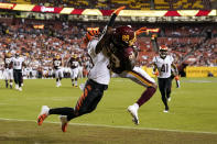 Washington Football Team wide receiver Cam Sims (89) catches a pass with coverage by Cincinnati Bengals defensive back Winston Rose (39) during the first half of a preseason NFL football game Friday, Aug. 20, 2021, in Landover, Md. The catch was ruled incomplete as Sims landed out of bounds. (AP Photo/Susan Walsh)