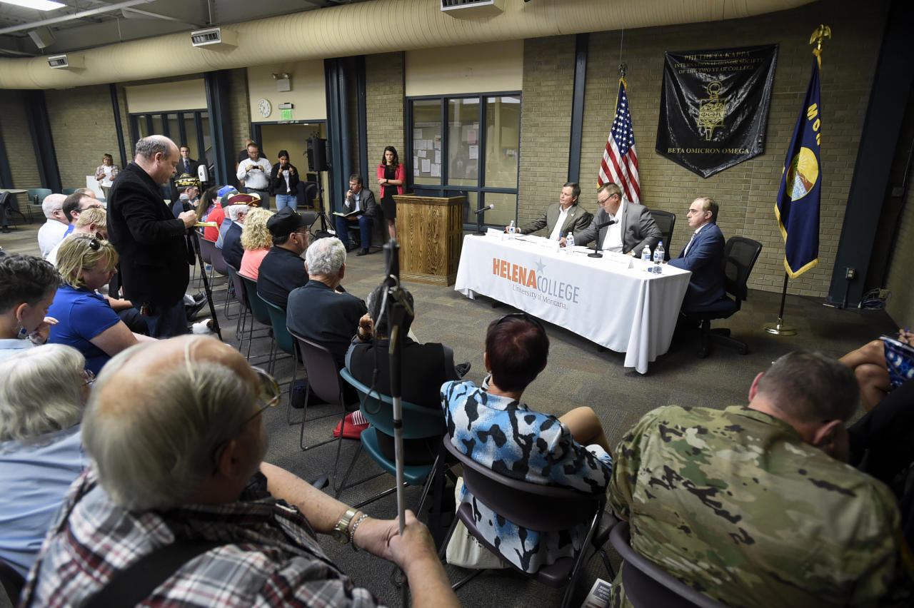 Sen. Steve Daines, Sen. Jon Tester and Veterans Affairs Secretary David Shulkin listen to questions Monday, Aug. 21, 2017, during a public forum regarding veterans' health care at Helena College in Helena, Mont. (Thom Bridge /Independent Record via AP)