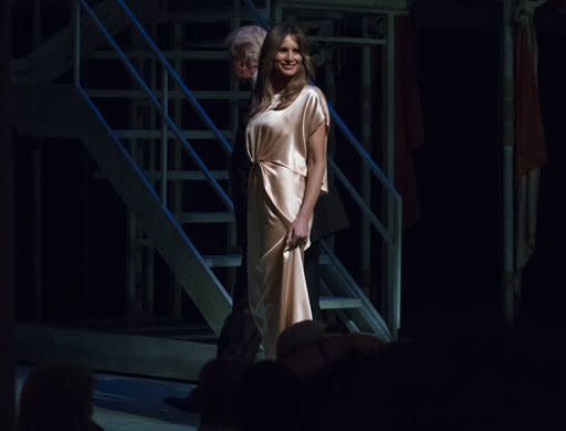 Melania Trump wore a silk gown by designer Monique Lhuillier to the event. (Photo: AP Images)