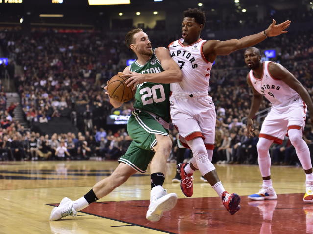 Boston Celtics forward Gordon Hayward (20) drives to the basket as Toronto Raptors guard Kyle Lowry (7) defends during first-half NBA basketball game action in Toronto, Friday, Oct. 19, 2018. (Frank Gunn/The Canadian Press via AP)