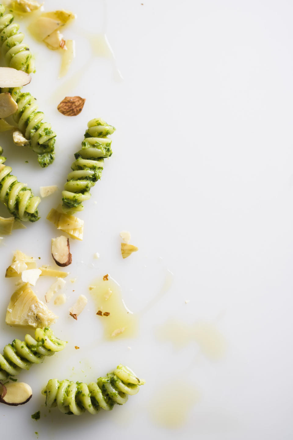 This image released by Milk Street shows a recipe for fusilli with fresh herbs and artichokes. (Milk Street via AP)