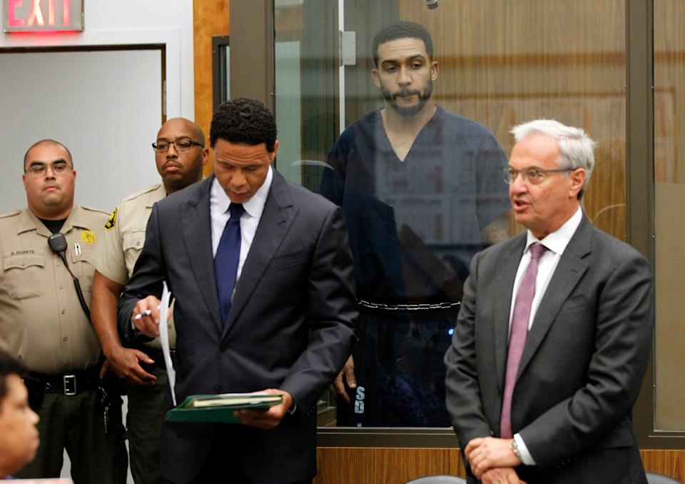Former NFL football player Kellen Winslow II, second from right, stands behind lawyers Brian Watkins, third from right, and Harvey Steinberg, right, during his arraignment in June 2018, in Vista, California. The former tight end was arrested on charges of rape and other sex crimes, the day he was to appear in court on an unrelated burglary charge. (AP)