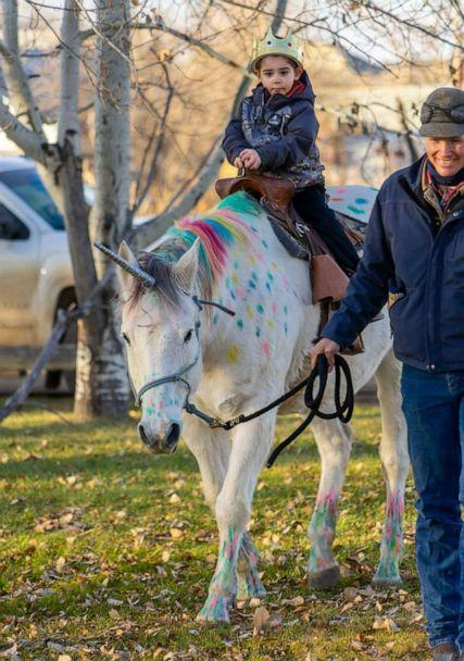 PHOTO: Wyatt Haas, a boy who loves unicorns met two in real life thanks to a send-off party from his kindergarten classmates in Fallon, Montana, on Dec. 6, as Wyatt heads to cancer treatment. (Jennifer Nielsen)