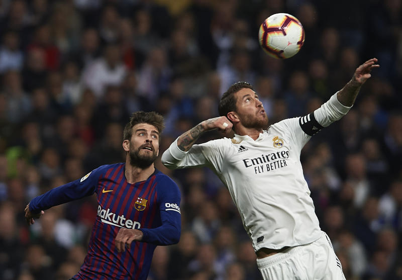MADRID, SPAIN - MARCH 02: Sergio Ramos of Real Madrid competes for the ball with Gerard Pique of Barcelona during the La Liga match between Real Madrid CF and FC Barcelona at Estadio Santiago Bernabeu on March 02, 2019 in Madrid, Spain. (Photo by Quality Sport Images/Getty Images)
