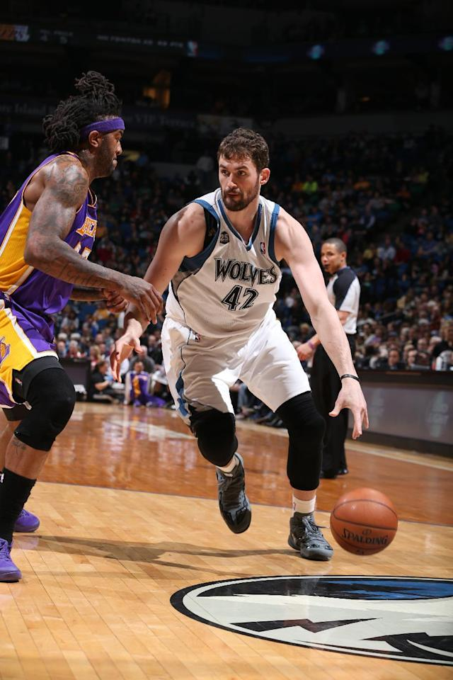 MINNEAPOLIS, MN - MARCH 28: Kevin Love #42 of the Minnesota Timberwolves handles the ball against the Los Angeles Lakers on March 28, 2014 at Target Center in Minneapolis, Minnesota. (Photo by David Sherman/NBAE via Getty Images)