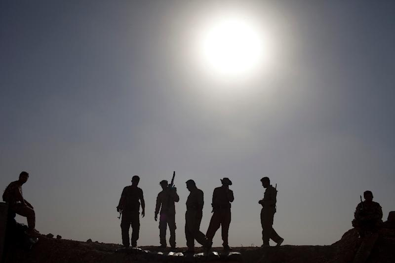 Kurdish Peshmerga fighters hold a position in Yangije, Iraq, on September 11, 2014