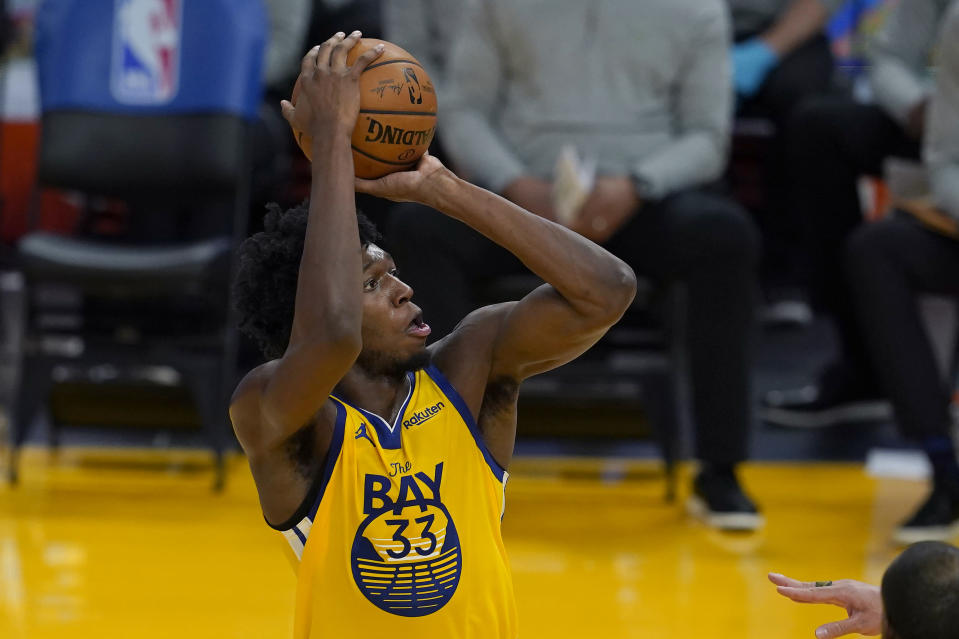 Golden State Warriors center James Wiseman (33) shoots against the Milwaukee Bucks during the first half of an NBA basketball game in San Francisco, Tuesday, April 6, 2021. (AP Photo/Jeff Chiu)