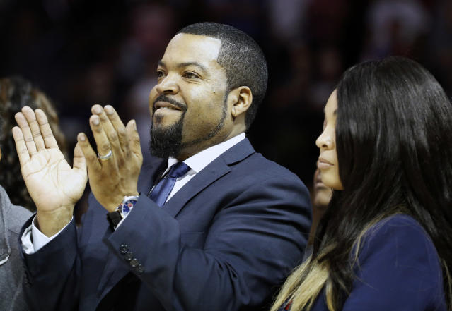 FILE - In this June 25, 2017 file photo Big3 Basketball League founder Ice Cube applauds the crowd during a timeout in the first half of Game 2 in the league's debut at the Barclays Center in New York. Ice Cube tips off talking about his BIG3 basketball league and also kicks it about his music and movies on PodcastOne Sports Now on Tuesday, July 31, 2018. (AP Photo/Kathy Willens, file)