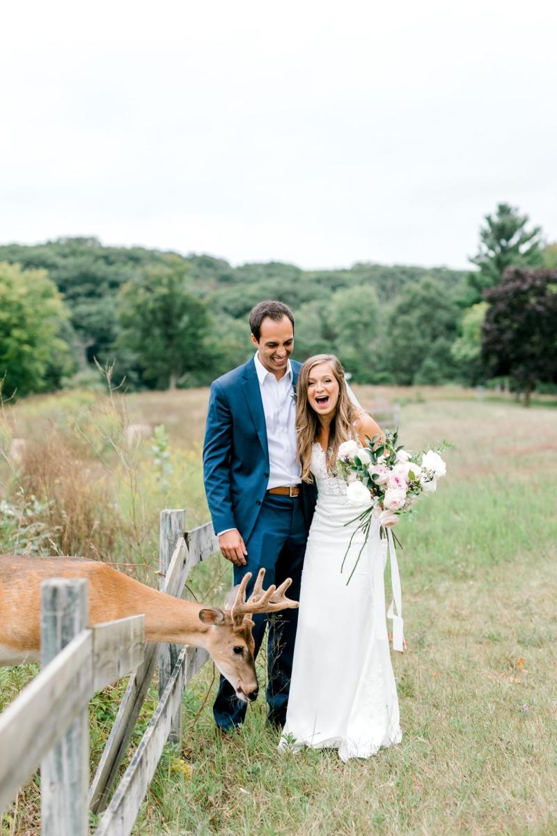 After their wedding ceremony, Luke and Morgan Mackley got to pose with a local deer, much to their amusement. (Photo: Laurenda Marie Photography)