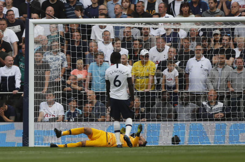 Tottenham's goalkeeper Hugo Lloris and Tottenham's Davinson Sanchez react after Aston Villa's John McGinn after scoring his side's opening goal during the English Premier League soccer match between Tottenham Hotspur and Aston Villa at the Tottenham Hotspur stadium in London, Saturday, Aug. 10, 2019. (AP Photo/Frank Augstein)