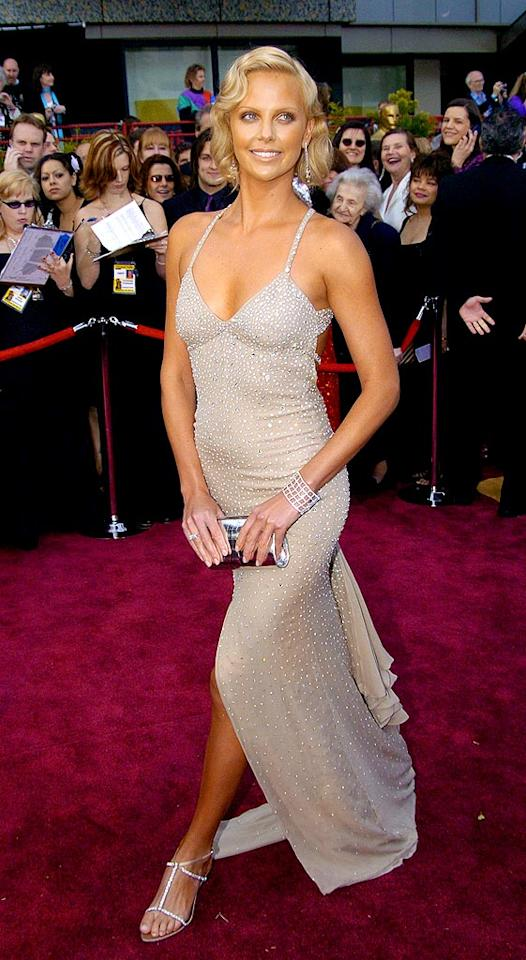 "And the award for best ensemble, despite a tan that made her appear slightly ill, goes to ... A-list actress Charlize Theron, on the red carpet at the 2004 Academy Awards. Jeff Kravitz/<a href=""http://www.filmmagic.com/"" target=""new"">FilmMagic.com</a> - February 29, 2004"