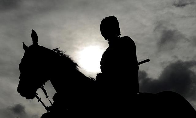 Horse Racing - Cheltenham Festival - Cheltenham Racecourse, Cheltenham, Britain - March 15, 2018 Silhouette of a jockey and horse before the 14:10 Pertemps Network Final Handicap Hurdle Action Images via Reuters/Andrew Boyers