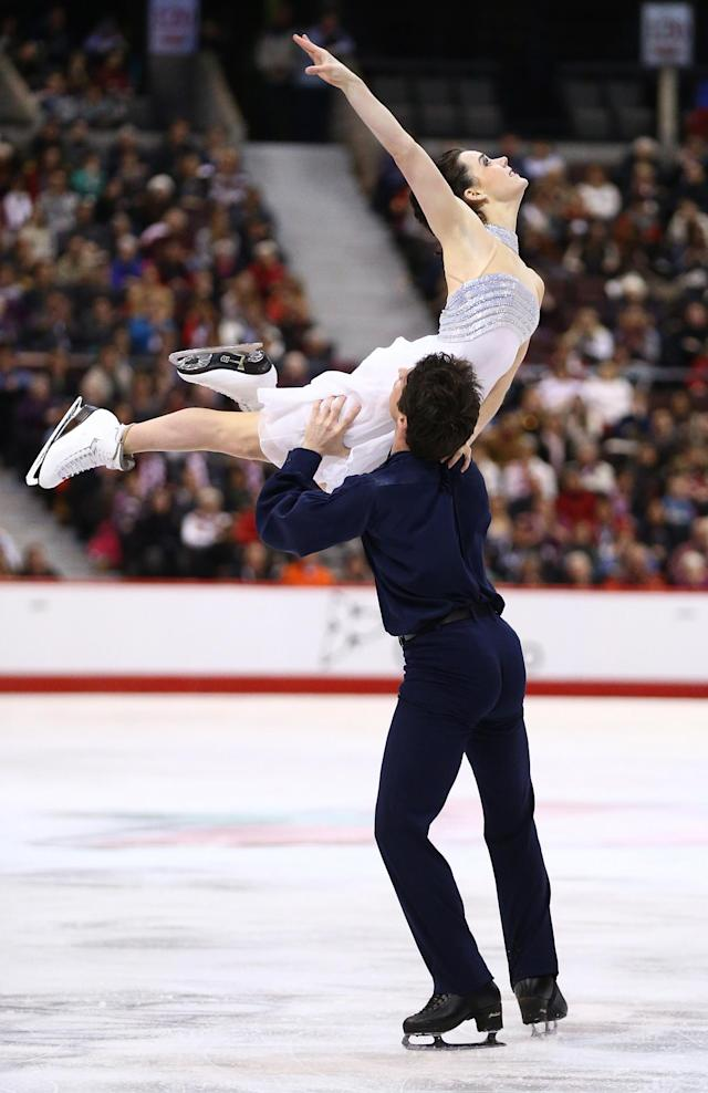 OTTAWA, ON - JANUARY 11: Tessa Virtue and Scott Moir skate in the Senior Ice Dance Free Dance during the 2014 Canadian Tire National Figure Skating Championships at Canadian Tire Centre on January 11, 2014 in Ottawa, Ontario, Canada. (Photo by Andre Ringuette/Getty Images)
