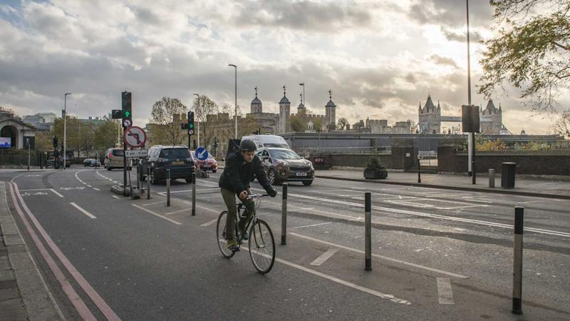 Cyclist on cycling lane near Tower Hill in London