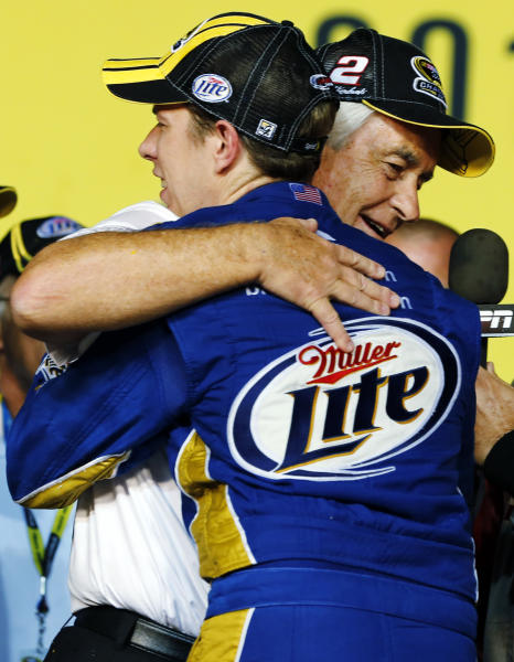 Brad Keselowski hugs owner Roger Penske after winning the NASCAR Sprint Cup Series championship following an auto race at Homestead-Miami Speedway, Sunday, Nov. 18, 2012, in Homestead, Fla. (AP Photo/Terry Renna)