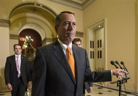 Boehner walks to the House floor during the vote on the fiscal deal in the U.S. Capitol in Washington